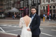 Wedding photo shooting. Bride and bridegroom walking in Amsterdam. Netherlands stock images