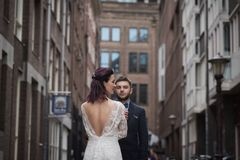 Wedding photo shooting. Bride and bridegroom walking in Amsterdam. Netherlands royalty free stock images