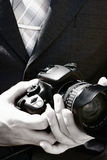 The wedding photographer. Behind work. Black-and-white Stock Photo