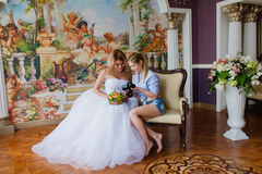 Wedding photographer discussing with the bride recently taken photos. In the studio royalty free stock photo