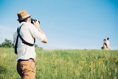 Wedding photographer takes pictures of bride and groom in nature, fine art photo Stock Images