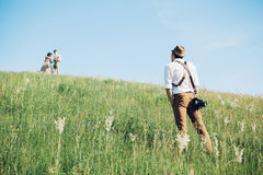Wedding photographer takes pictures of bride and groom in nature, fine art photo Stock Photography
