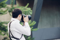 Wedding photographer takes pictures in summer Royalty Free Stock Image