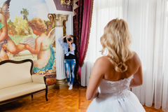 Wedding photographer is taking pictures the bride Royalty Free Stock Photos