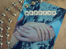 Wedding photography, feather and word of beads Royalty Free Stock Photography