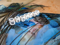 Wedding photography, feather and word of beads Stock Photos