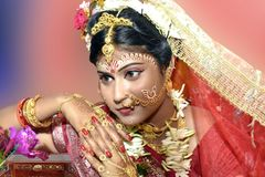 Wedding photography of a girl with golden jewelry stock photo