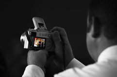 Wedding Photography I. A wedding guest photographs the ceremony on his digital camera Royalty Free Stock Image