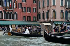 Wedding photography in Venice and gondolas in movement. Royalty Free Stock Photo