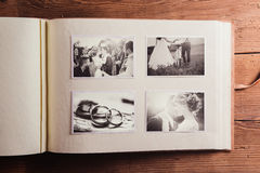Wedding photos. In album. Studio shot on wooden background royalty free stock image