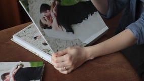 Wedding photos in photobook stock footage