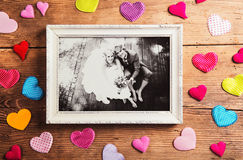 Wedding photos. Picture frame with wedding photo. Studio shot on wooden background royalty free stock photography