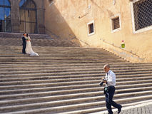 Wedding Photos in Rome. A couple kisses while posing for their wedding photos in Rome, Italy, a city known for romance and love royalty free stock photography