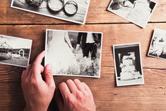 Wedding photos on a table. Wedding photos laid on a table. Studio shot on wooden background royalty free stock photography