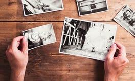 Wedding photos on a table. Wedding photos laid on a table. Studio shot on wooden background royalty free stock photos