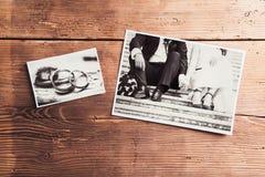 Wedding photos on a table. Wedding photos laid on a table. Studio shot on wooden background stock photos