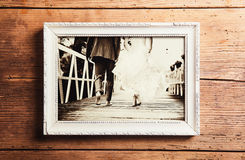 Wedding photos on a table. Picture frame with wedding photo. Studio shot on wooden background stock photo