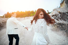 Wedding photosession of young couple near forest Royalty Free Stock Photography