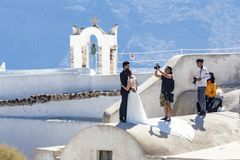 Wedding photoshoot on top of roof in Oia, Santorini, Greece stock images