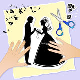Wedding picture. Lovers' hands creating a wedding scene out of paper Stock Images
