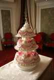 Wedding pie. The three-tier wedding pie decorated by flowers from cream Stock Images