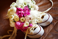 Wedding pink flowers with sneakers Royalty Free Stock Photography