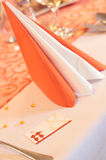 Wedding place card. And doily in orange on table. lovely couple Stock Photo