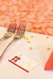 Wedding place card. And two forks on table in orange. lovely couple Royalty Free Stock Photo