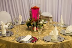 Wedding Place Setting, Cater, Catering. Table place setting for a wedding reception and party. A caterer who does catering and food and beverage services will stock photo
