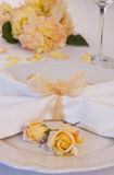 Wedding place setting with roses Stock Images