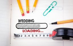 Wedding Planner Notebook. pencils, pen and tape measure on a paper background.  Royalty Free Stock Photography