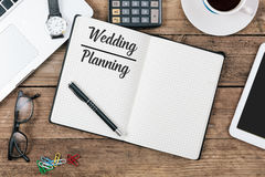 Wedding Planning text, Office desk with computer technology, hig Royalty Free Stock Photo