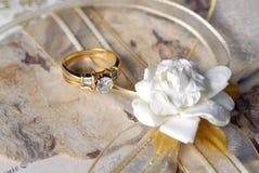 Wedding plans. Wedding ring on a fancy wedding invitation Royalty Free Stock Photos