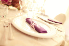 Wedding plates with purple napkin Royalty Free Stock Photography