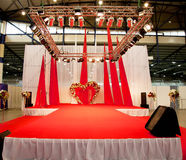 Wedding podium covered with red carpet. Studio lights Royalty Free Stock Image