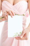 Wedding polygraphy. Invitation in the hands of women. Royalty Free Stock Image