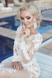 Wedding portrait of  blond bride woman with makeup, bridal jewelry Stock Photo
