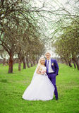 Wedding portrait of the bride and groom in the spring garden Royalty Free Stock Photos