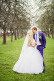 Wedding portrait of the bride and groom in the spring garden Stock Photo
