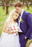 Wedding portrait of the bride and groom in the spring garden Royalty Free Stock Photography