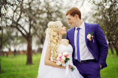 Wedding portrait of the bride and groom in the spring garden Stock Photos