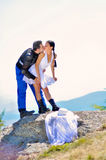 Wedding portraits. A just married couple, on the mountain stock photo