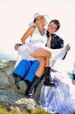 Wedding portraits. A just married couple, on the mountain stock images
