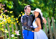 Wedding portraits. A just married couple, next to a garden full of flowers stock photography