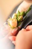 Wedding posy. On the lapel of groom's jacket Royalty Free Stock Photo