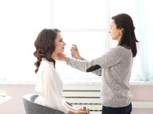 Wedding preparation. Beauty and makeup. Visagiste at work Royalty Free Stock Photos