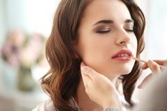 Wedding preparation. Beauty and makeup. Visagiste at work Stock Photos