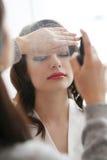 Wedding preparation. Beauty and makeup. Visagiste at work Stock Photo