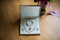 Wedding preparation, pendant, chain and earrings Royalty Free Stock Photo
