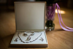 Wedding preparation, pendant, chain and earrings for women Royalty Free Stock Images